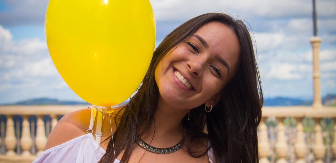 Smiling girl with balloon